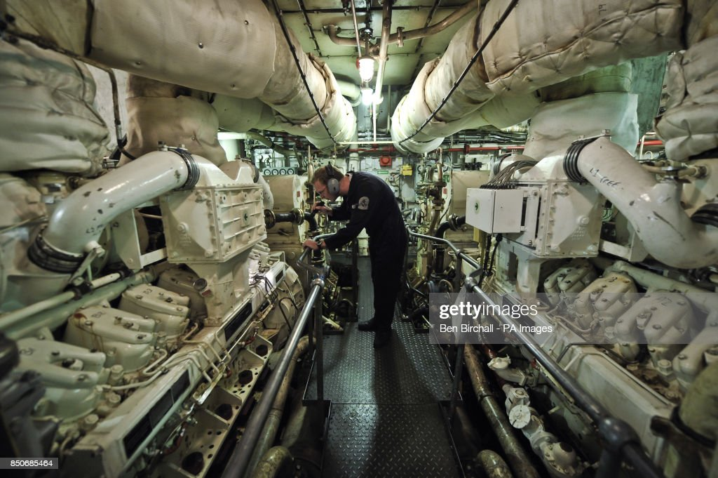 A Royal Navy Mechanical Engineer checks one of two V16 diesel