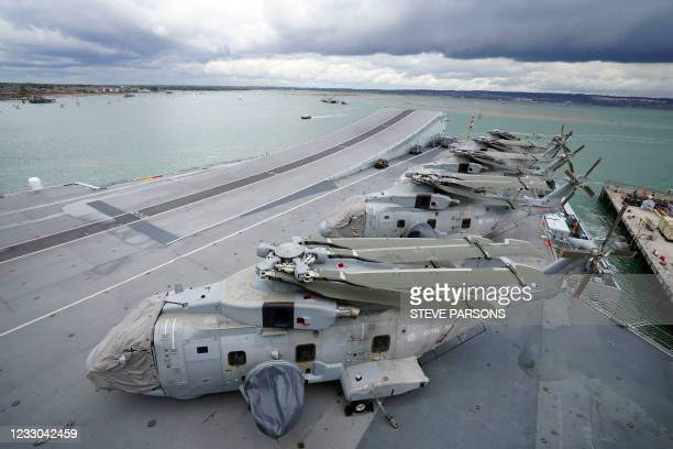 Royal Navy Merlin Mk2 Crowsnest helicopters are pictured on the flight deck of the aircraft carrier HMS Queen Elizabeth in Portsmouth, southern...