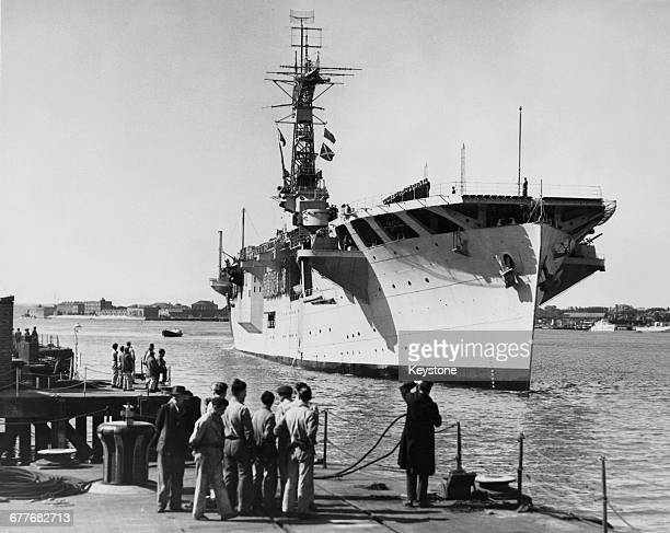 Royal Navy Nairanaclass escort aircraft carrier HMS Campania comes into port to be readied as the command ship for Operation Hurricane the test of...
