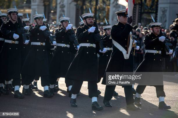 Royal Navy officers march into the palace before the British Royal Navy perform their first changing of the guard ceremony at Buckingham Palace on...