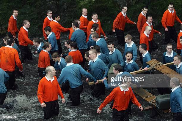 Royal Navy personel and recruits take part in exercises in water in the harbour at the Piers Cellars training centre as they take part in...