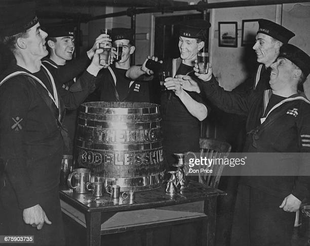 Royal Navy ratings '' splice the mainbrace'' with an extra ration of rum from the rum tub to celebrate the birth of HRH Charles Prince of Wales at...