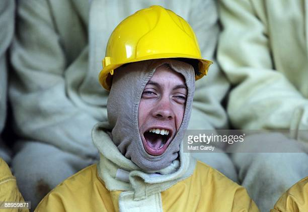 Royal Navy recruit makes a face while learning fire fighting techniques during a exercise at the training establishment HMS Raleigh during the final...