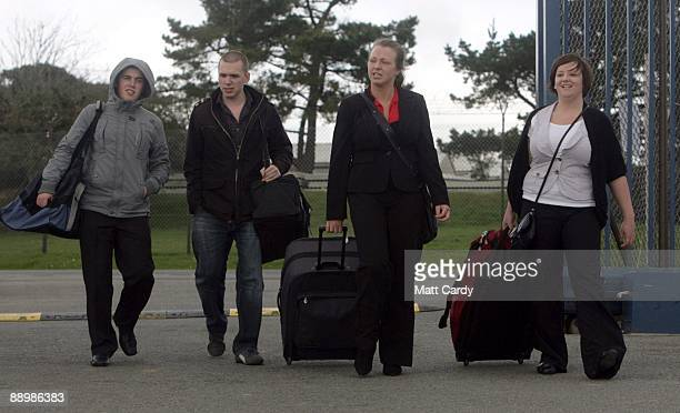 Royal Navy recruits Daniel Wright Mike Ellsbury Vicky Reynolds and Sam Richards arrive at the training establishment HMS Raleigh on the first day of...