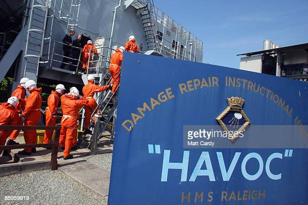 Royal Navy recruits enter a sinking ship simulator known as a Damage Repair Instructional Unit or HAVOC at the training establishment HMS Raleigh...