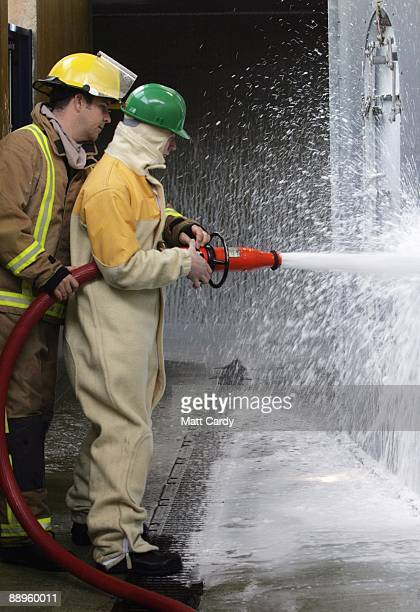 Royal Navy recruits learn fire fighting techniques during a exercise at the training establishment HMS Raleigh during the final week of their initial...