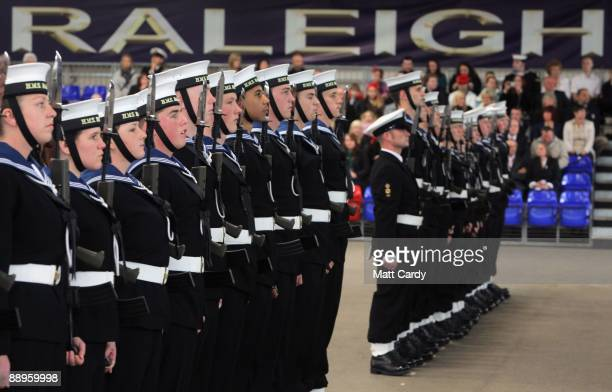 Royal Navy recruits line up waiting to be inspected during their passing out parade at the training establishment HMS Raleigh on the final day of...