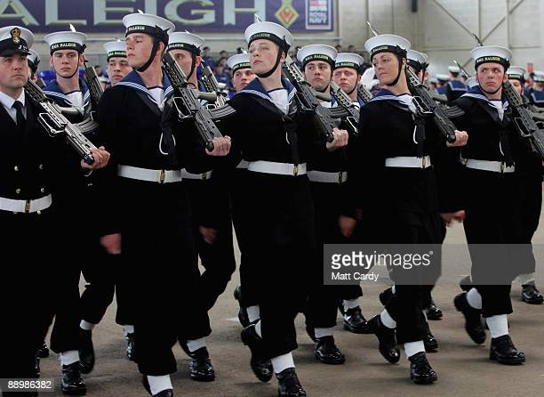 Royal Navy recruits march during their passing out parade at the training establishment HMS Raleigh on the final day of their initial nine-week basic...