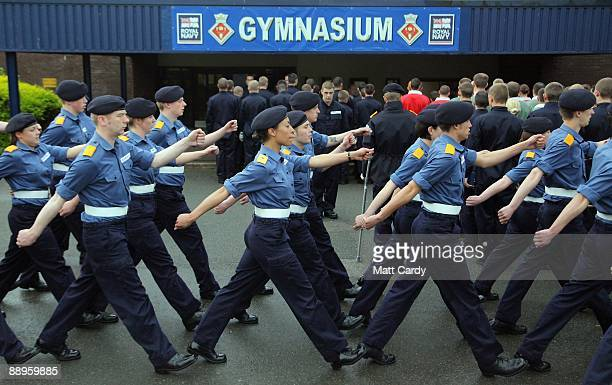 Royal Navy recruits march past the gymnasium at the training establishment HMS Raleigh on the final day of their initial nineweek basic naval...