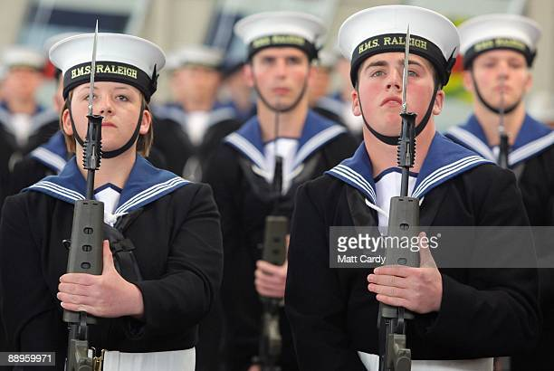 Royal Navy recruits Nicola Morris and Daniel Wright stand to attention during their passing out parade at the training establishment HMS Raleigh on...