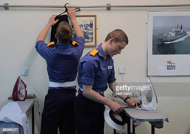 Royal Navy recruits prepare their kit and dress in preparation of their passing out parade at the training establishment HMS Raleigh on the final day...