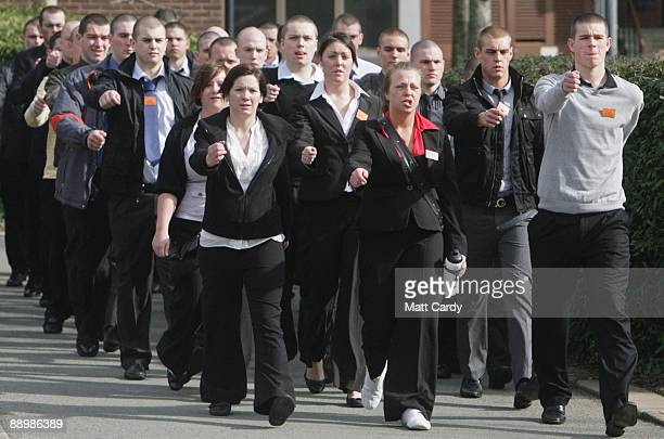 Royal Navy recruits, still in their civilian clothes, are marched to the clothing store as they arrive at the training establishment HMS Raleigh for...