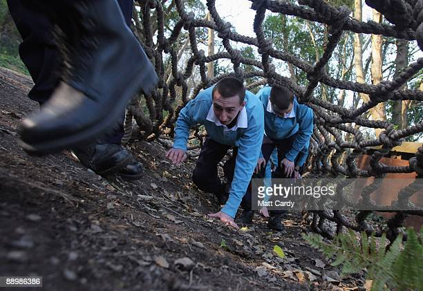 Royal Navy recruits train on the obstacle course at the Piers Cellars training centre as they take part in teambuilding exercises close to the...