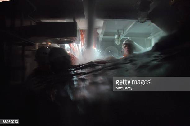 Royal Navy recruits try evacuate from a sinking ship simulator known as a Damage Repair Instructional Unit or HAVOC at the training establishment HMS...