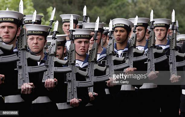 Royal Navy recruits with Daniel Wright line up as they wait to march to their passing out parade at the training establishment HMS Raleigh on the...