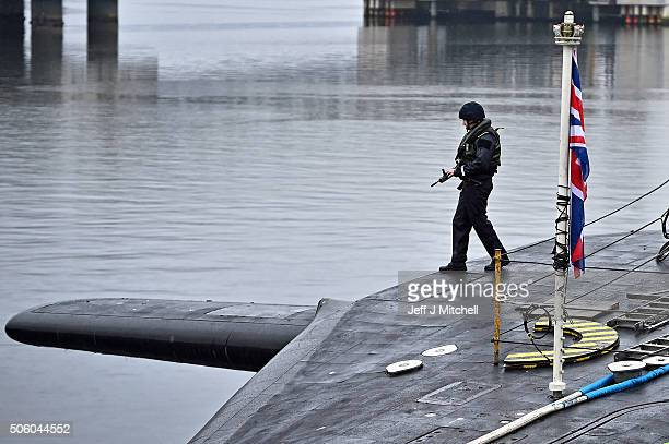 Royal Navy security personnel stand guard on HMS Vigilant at Her Majesty's Naval Base, Clyde on January 20, 2016 in Rhu, Scotland. HMS Vigilant is...