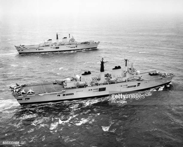 Royal Navy warships HMS Illustrious foreground and HMS Ark Royal in close formation in the North Sea off the Firth of Forth after conducting joint...
