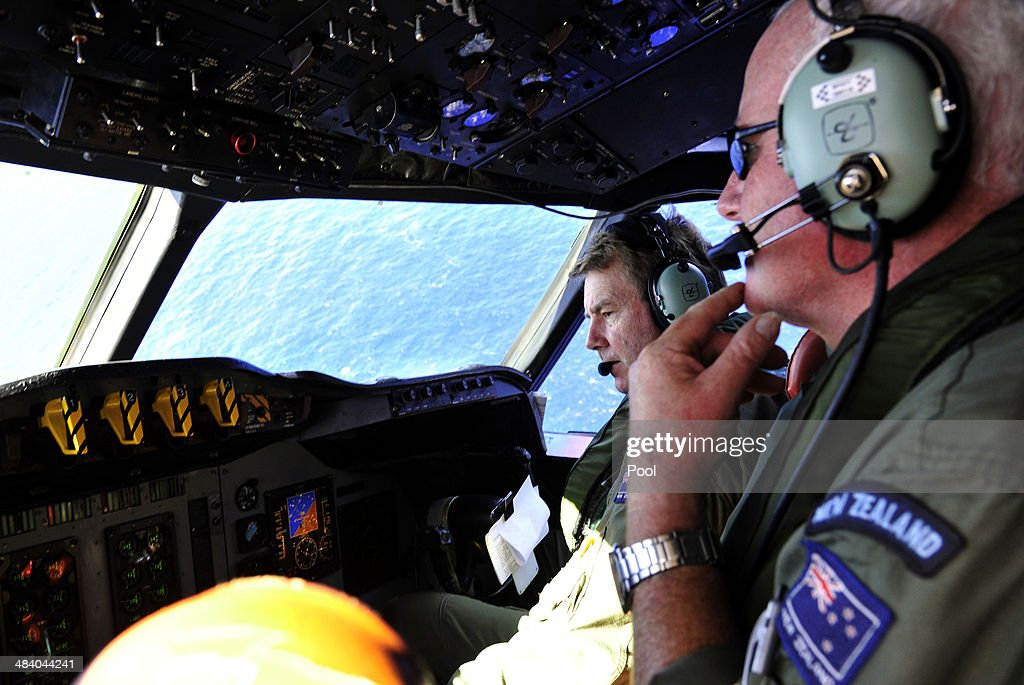Royal New Zealand Air Force (RNZAF) Co Pilot squadron Leader Brett McKenzie (L) and Flight Engineer Trent Wyatt sit in the cockpit aboard a P3 Orion maratime search aircraft as it flies over the southern Indian Ocean looking for debris from missing Malaysia Airlines flight MH370 on April 11, 2014 At Sea. Search and rescue officials in Australia are confident they know the approximate position of the black box recorders from missing Malaysia Airlines Flight MH370, Australian Prime Minister Tony Abbott said on Friday. At the same time, however, the head of the agency coordinating the search said that the latest 'ping' signal, which was captured by a listening device buoy on Thursday, was not related to the plane.