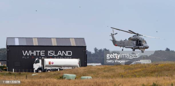 Royal New Zealand Air Force helicopter takes off from Whakatane Airport to return to White Island to retrieve bodies on December 13 2019 in Whakatane...