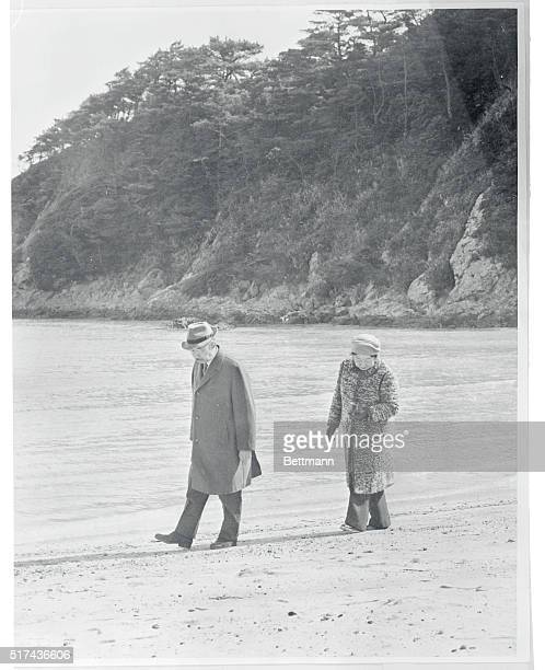 Royal Outing Shimoda Japan Japan's Emperor Hirohito and Empress Nagako stroll along shore during a visit to their newlybuilt seaside villa 'Susaki'...