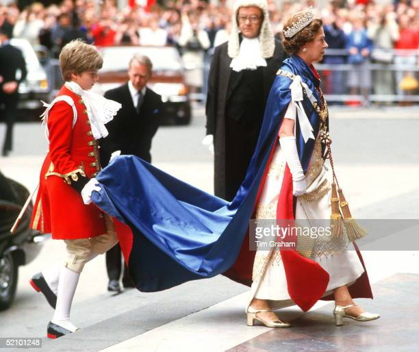 Royal Page Holding The Train Of The Queen's Cloak As She Is Arriving At St Paul's Cathedral For The Service Of St Michael And St George