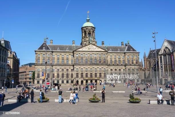 royal palace, dam square, amsterdam, netherlands - royal palace amsterdam stock pictures, royalty-free photos & images