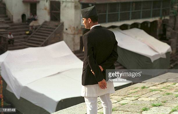 Royal Palace Officer watches the preparation of the cremation site of the Nepalese royal family June 2 2001 at the Pashupati Nath Araya Ghat complex...