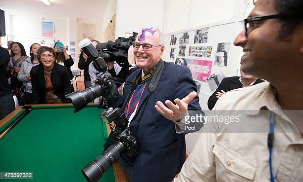 Royal photographer Arthur Edwards is seen with Prince Harry's hand print on his forehead during Prince Harry's visit to the TYLA youth development...