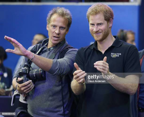 Royal photographer Chris Jackson goes over medal ceremony order with Prince Harry after the Gold Medal game on Day Eight in Wheelchair Basketball...