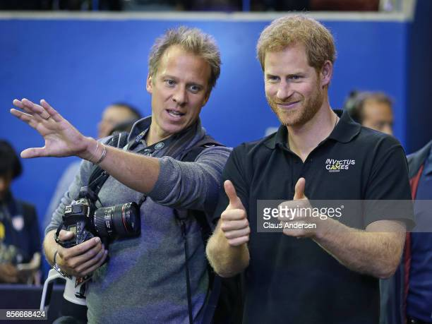 Royal photographer Chris Jackson goes over order of medal presentation with Prince Harry after the Gold medal game on Day Eight in Wheelchair...