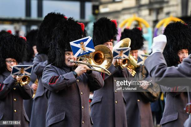Royal Regiment of Scotland Band marches down from Edinburgh Castle Esplanade to St Giles Cathedral for a Commemoration service for Dr Elsie Ingles on...