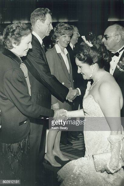 Royal Romanian welcome Georgette Vujcuf curtsies as she meets Queen Anne of Romania and King Michael at Toronto's Hilton hotel The royal couple...