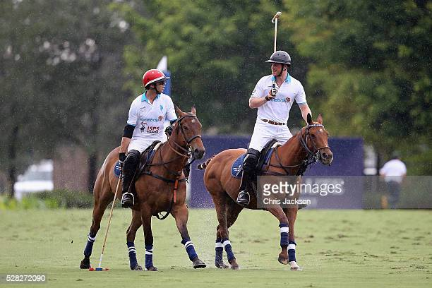 Royal Salute World Polo Ambassador Malcolm Borwick and Prince Harry compete during the Sentebale Royal Salute Polo Cup in Palm Beach at Valiente Polo...