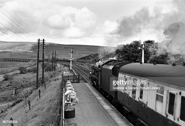 Royal Scot Class steam locomotive No 46112 at Garsdale Station heading for Glasgow Photograph by Bishop Eric Treacy Treacy was often allowed special...