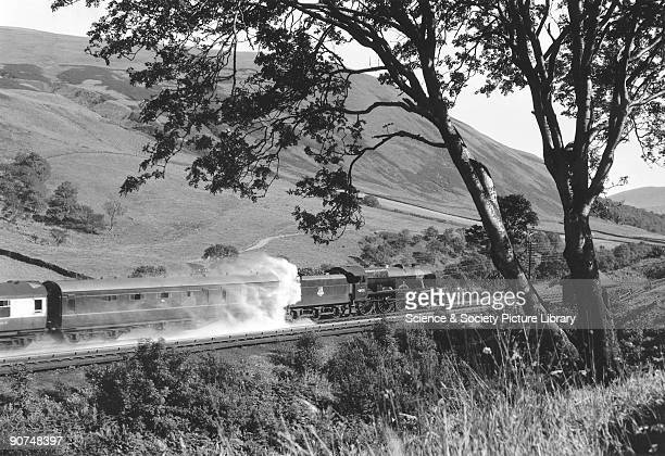 Royal Scot class steam locomotive No 46121 'Highland Light Infantry City of Glasgow Regiment' The water spraying out from the locomotive is due to...