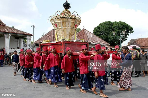 Royal servants of the sultan's palace carry offerings during a traditional ceremony called quotGrebeg Syawalquot that is a part traditional Eid...