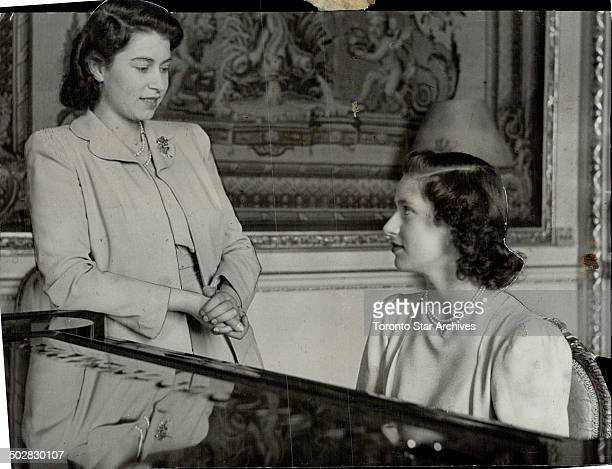 Royal sisters Princess Elizabeth and Princess Margaret Rose seated at the piano were caught in this informative pose in Buckingham Palace recently...