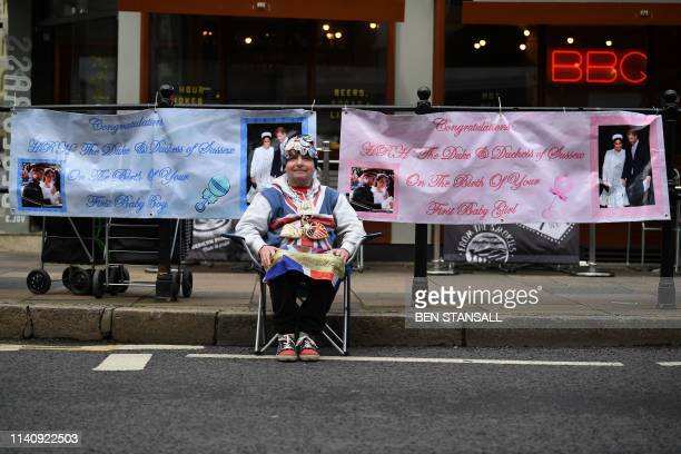 Royal super fan John Loughery poses as he sits in Windsor waiting for news of the imminent birth of the child of Britain's Prince Harry and Meghan...