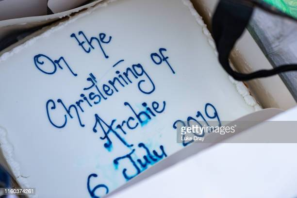Royal super fans show a cake to celebrate the christening on the day that Archie Harrison MountbattenWindsor son of The Duke Duchess of Sussex was...