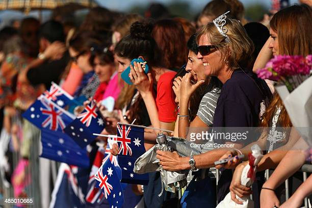 Royal supporters wait for the arrival of the Duke and Duchess of Cambridge at the Sydney Opera House on April 16 2014 in Sydney Australia The Duke...