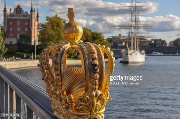 royal swedish crown on skeppsholmen bridge, stockholm, sweden - stockholm stock pictures, royalty-free photos & images