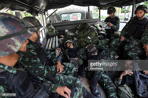 Royal Thai Army soldiers rest in the back of a military vehicle stationed outside luxury hotels on Ratchadamri Road in central Bangkok, Thailand, on...