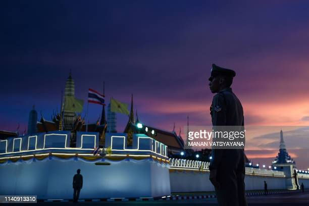 Royal Thai police stand guard near the Grand Palace in Bangkok on May 3 ahead of Thailand's King Maha Vajiralongkorn's coronation which will take...