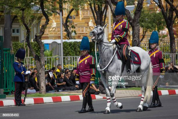 Royal Thai soldiers are seen taking part of the Royal Ceremony as they transfer the Thailand's Late King Bhumibol Adulyadej's ashes and relics into...
