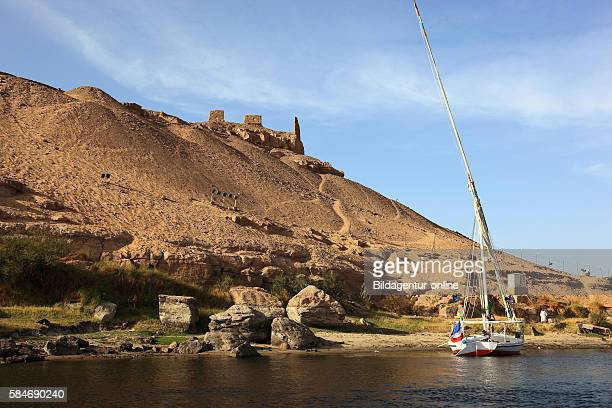 Royal Tombs, sailboat on the shore of the Nile at Aswan, Upper Egypt, Africa.
