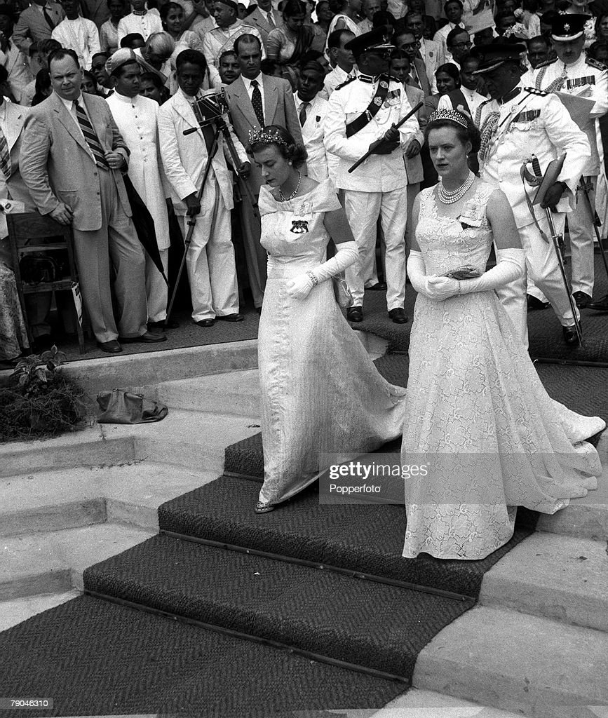 Royal Tour. Ceylon. 1954. The Ladies in waiting to Queen Elizabeth II, Lady Pamela Mountbatten and Lady Alice Egerton, are pictured leaving after the opening of Parliament at Freedom Hall, Colombo. : News Photo