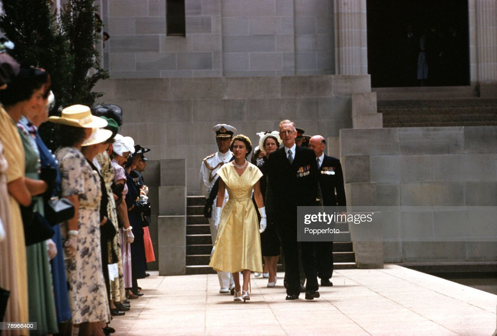 1954. Royal Tour of Australia. Queen Elizabeth II and Prince Philip, the Duke of Edinburgh, are pictured passing the Pool of Reflection lined by relatives of fallen servicemen, as they left the Australian War Memorial at Canberra. Behind is the Dome of Me : News Photo