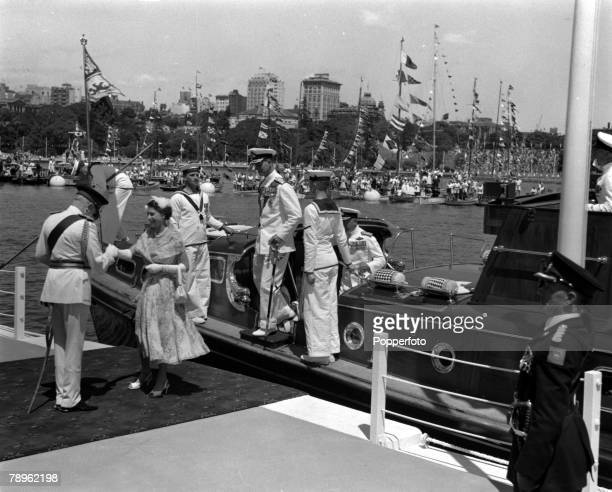 Royal Tour of Australia Queen Elizabeth II and the Duke of Edinburgh step from the Royal Barge at Farm Cove Sydney to be greeted by the Governor...