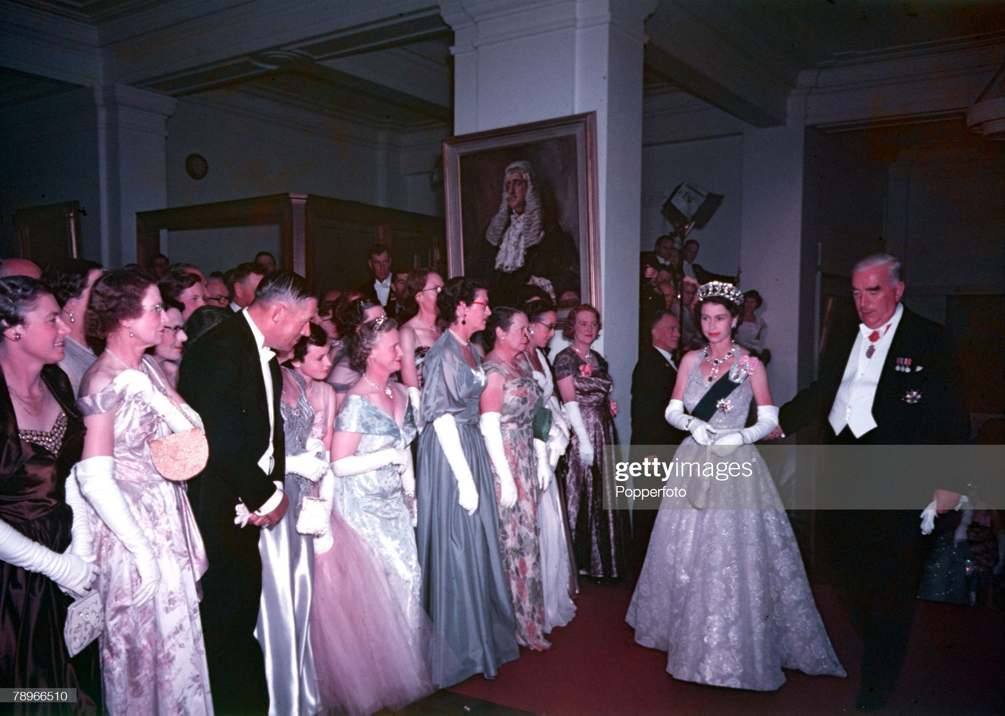 1954. Royal Tour of Australia. Queen Elizabeth II is pictured accompanied by Prime Minister Mr Menzies as she passes lines of guests at the State Ball held at Parliament House. : News Photo