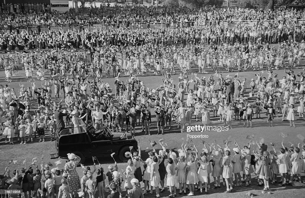 1954, Royal Tour of Australia, the picture shows Queen Elizabeth and the Duke of Edinburgh in a Land Rover as they drove through lanes of children at Bendigo, where 16,000 children assembled to greet them. : News Photo